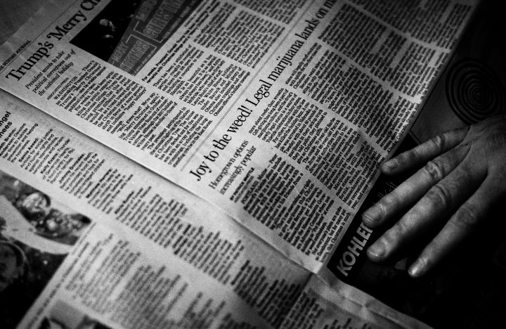 Black and white photo of newspaper