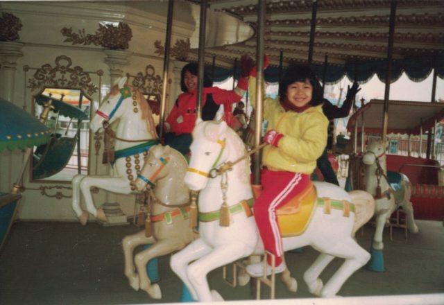 sisters on a ferris wheel