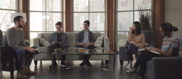 Group of people sitting on couches.