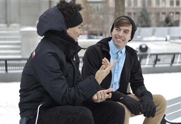 Two friends talking outside.