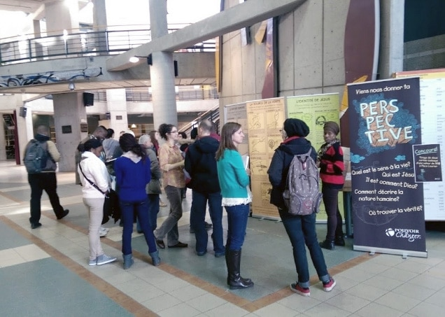 Power to Change - Students sharing the gospel on campus beside 'Perspective' banners.
