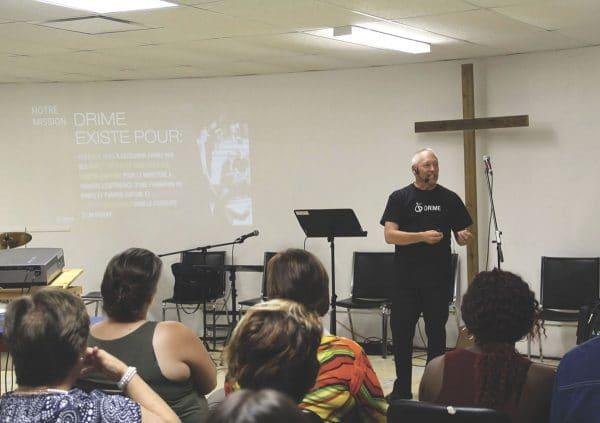 DRIME team leader preaching a seminar